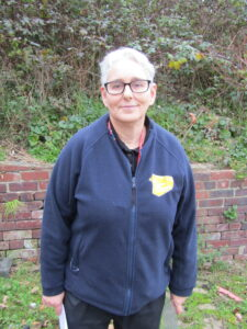 A women with grey hair and glasses wearing a fleece jacket